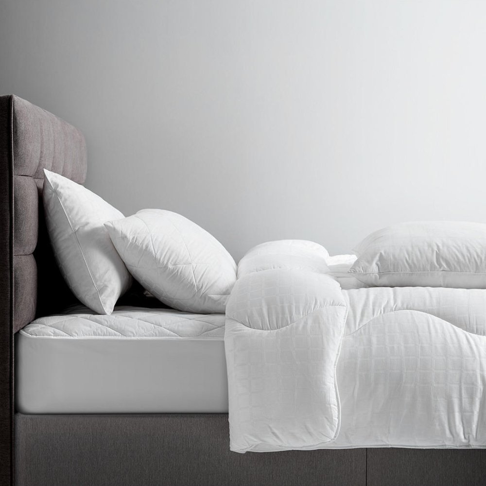 Impereal-Quilted-Pillows-OnBed